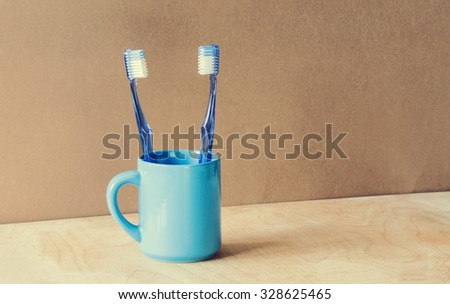 beautiful blue Toothbrushes on wood grunge background and awesome effect colors . - stock photo
