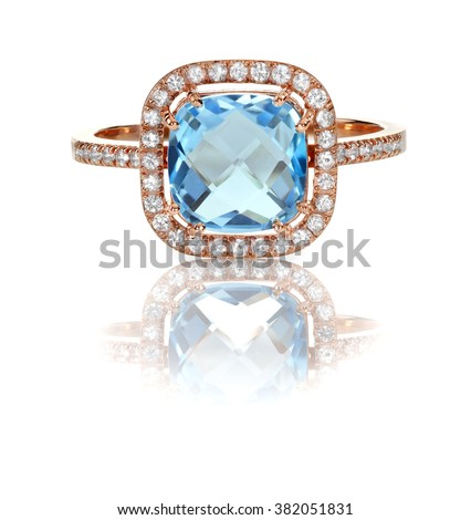 Beautiful Blue Topaz and diamond Rose Gold Halo Ring Cushion Cut with a square princess style setting - stock photo
