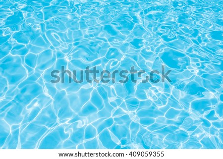 Beautiful blue water in swimming pool with sun reflection - stock photo