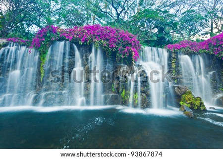 Beautiful Blue Waterfall in Hawaii - stock photo