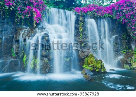 Beautiful Blue Waterfall in Hawaii - stock photo