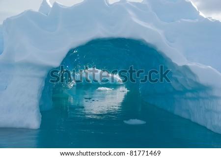 Beautiful blue whole in iceberg, Antarctica - stock photo