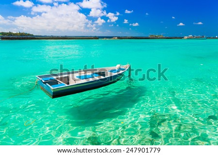 beautiful boat Maldives  atoll island paradise luxury  resort about coral reef in transparent water amazing  fresh  freedom snorkel adventure - stock photo