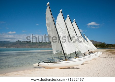 beautiful boats parked on the white sand of Indian Ocean - stock photo
