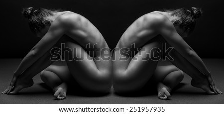 beautiful bodies of young women over dark background - stock photo