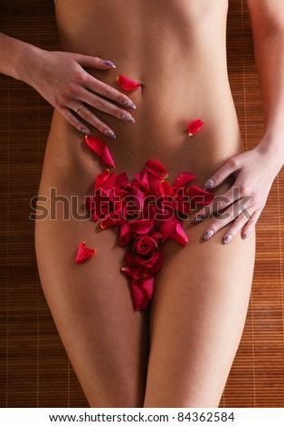 Beautiful body of young and attractive woman - stock photo