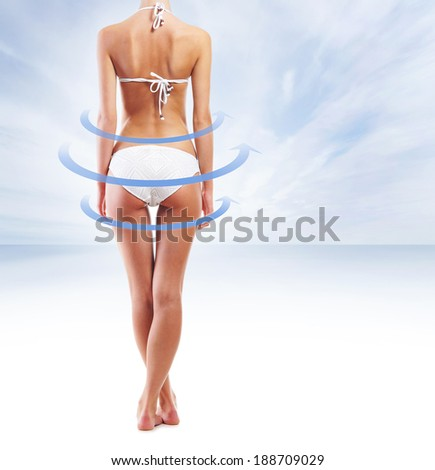 Beautiful body with the blue spiral over the sea background (healthy eating and water balance concept) - stock photo