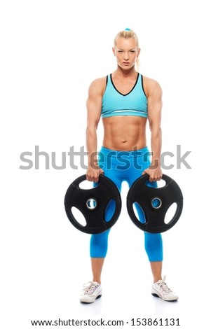 Beautiful bodybuilder girl holding weights isolated on white background  - stock photo