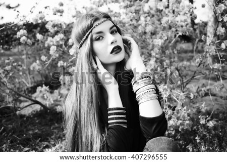 Beautiful bohemian girl in spring garden. Black and white photo of beautiful woman - stock photo