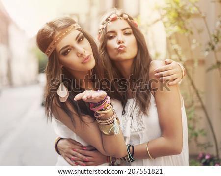 Beautiful boho girl blowing a kisses  - stock photo