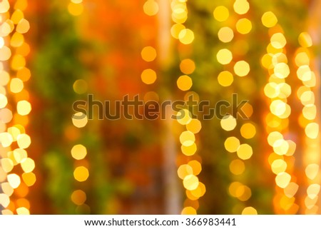 Beautiful bokeh light with red brick wall and green ivy on the background. - stock photo
