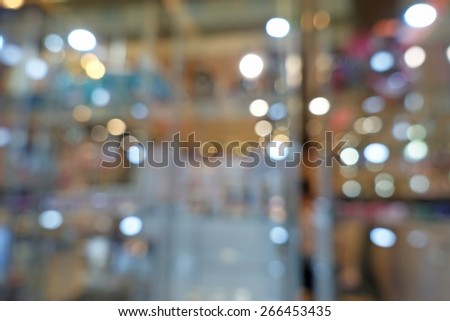 Beautiful bokeh lights reflected in a shop window,shallow depth of focus - stock photo