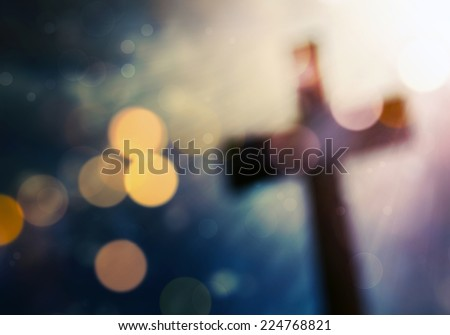 Beautiful bokeh with a cross in the background - stock photo