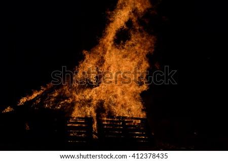 beautiful bonfire in dark winter night - stock photo