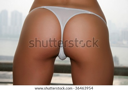 "beautiful bottom with a nice white cute string and perfect skin. some people call this a ""perfect ass"" sorry for this bad word"