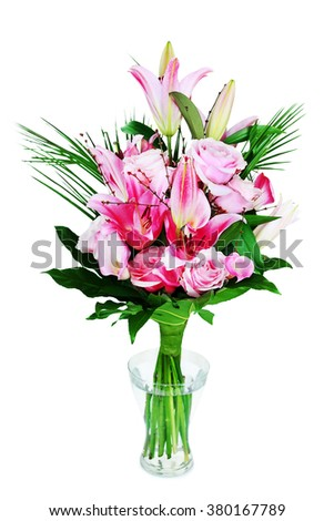 beautiful bouqet of pink lillyes and roses in vase