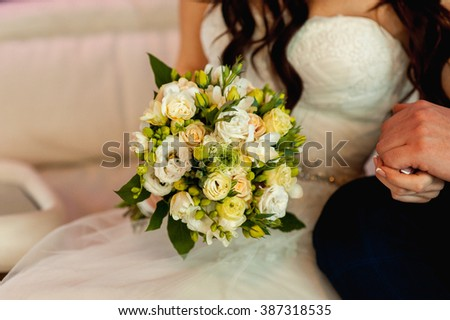 beautiful bouquet in hands of the bride is very stylish with light hair