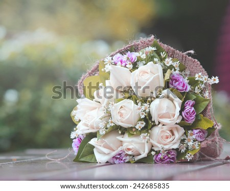 beautiful bouquet of bright white rose flowers table - stock photo