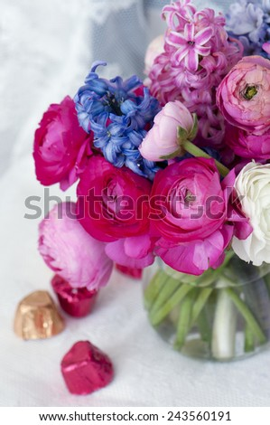 beautiful bouquet of colorful spring flowers.  ranunculus, hyacinth and chocolate - stock photo