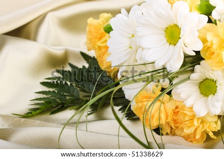 Beautiful bouquet of flowers on background of beige sateen - stock photo
