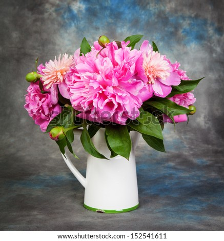 Beautiful bouquet of flowers - peonies. Dramatic light - stock photo