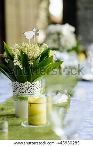 beautiful bouquet of lilies of the valley on the wedding table