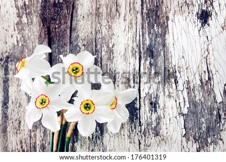 Beautiful bouquet of  narcissus  on old wooden background - stock photo