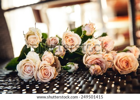 Beautiful bouquet of peach roses in vintage style. Valentine's Day