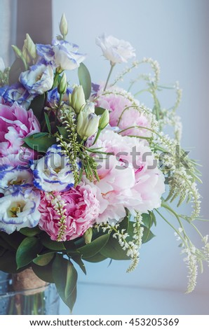 Beautiful bouquet of pink peonies, peony, roses, eustoma flowers in vase on white window background. Spring or summer lovely bouquet. Fresh floral. Pastel color purple, green. Text, copy space - stock photo