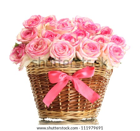 beautiful bouquet of pink roses in basket, isolated on white - stock photo