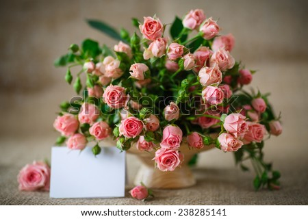 beautiful bouquet of pink roses on an old table of burlap - stock photo