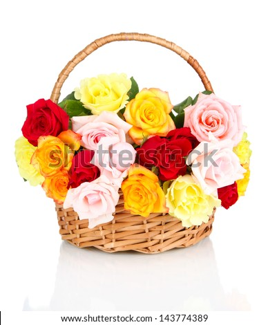 Beautiful bouquet of roses in wicker basket isolated on white - stock photo