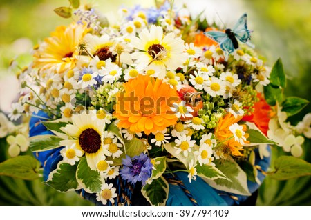 Beautiful bouquet of simple wild flowers. Toned photo - stock photo