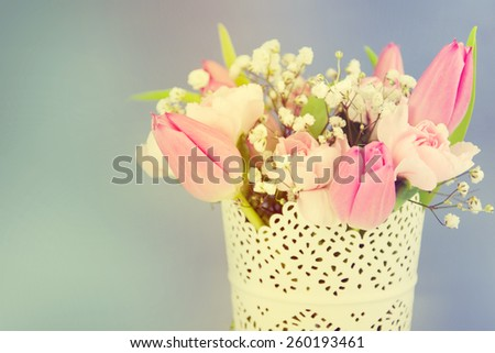 Beautiful bouquet of spring flowers in a vase. - stock photo