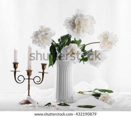 Beautiful bouquet of white peonies and candle stick on a white background - stock photo