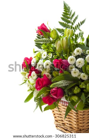 Beautiful bouquet with pink roses in wooden basket