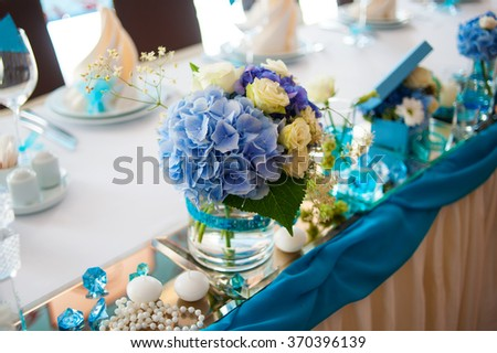 beautiful bouquets decoration on wedding table in a restaurant. - stock photo