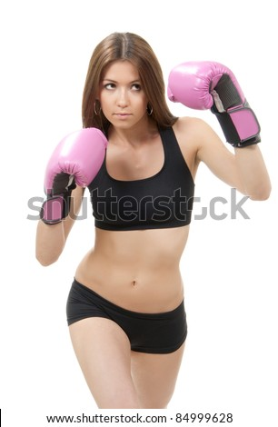 Beautiful Boxing Woman in pink box gloves ready to attack isolated on a white background - stock photo