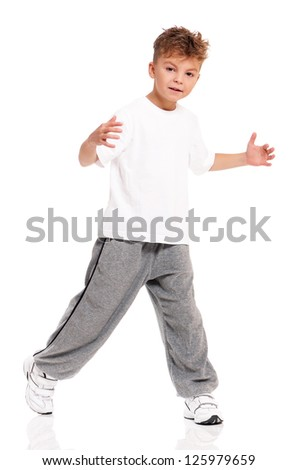 Beautiful boy, dressed in white T-shirt, dancing isolated on white background - stock photo