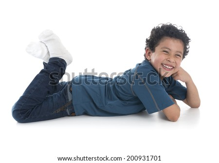 Beautiful Boy Laying Down Isolated on White Background - stock photo
