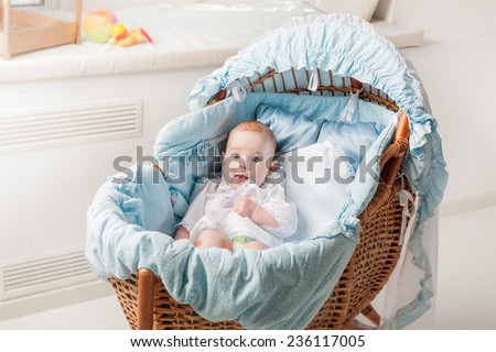 Beautiful boy lying in cradle - stock photo