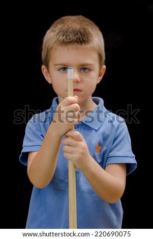 Beautiful boy playing billiard (pool) - stock photo