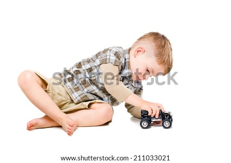 Beautiful boy playing toy car - stock photo