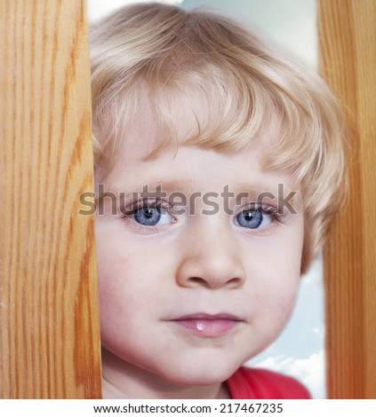 Beautiful boy. To take a broad view of the world open eyes. - stock photo