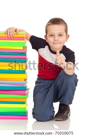 beautiful boy with school books, showing OK sign,  isolated on white - stock photo