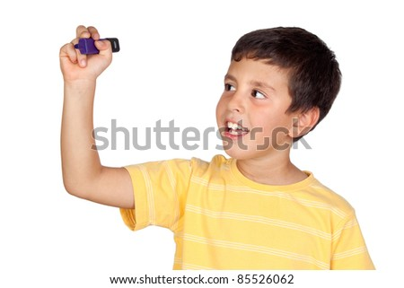 Beautiful boy writing something isolated on a over white background - stock photo