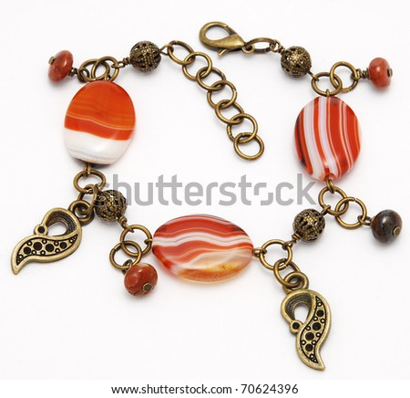 Beautiful bracelet from sardonyx on a white background - stock photo