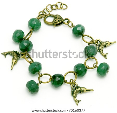 Beautiful bracelet made from natural jade stone by hand on a white background - stock photo