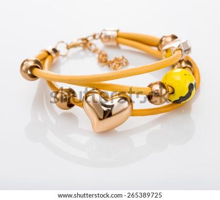 Beautiful bracelets on white background. - stock photo