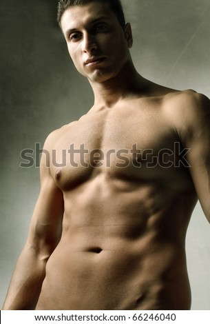 Beautiful brawny naked man - stock photo